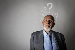 bigstock old man and question marks de 351898700